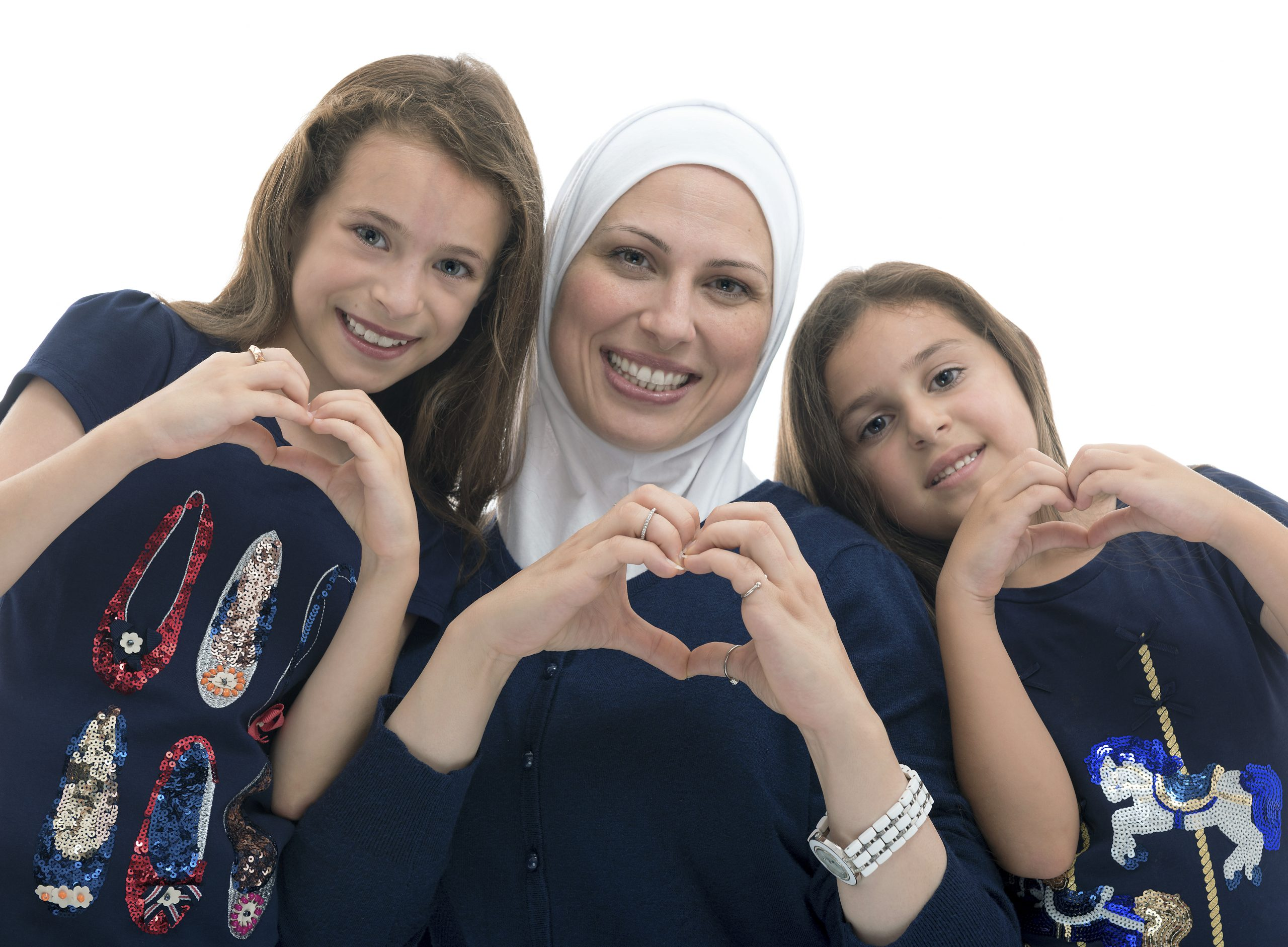 Happy Muslim Female Family, Mother and Her Daughters With Hand Gesture of Heart Love Sign Isolated on White Background