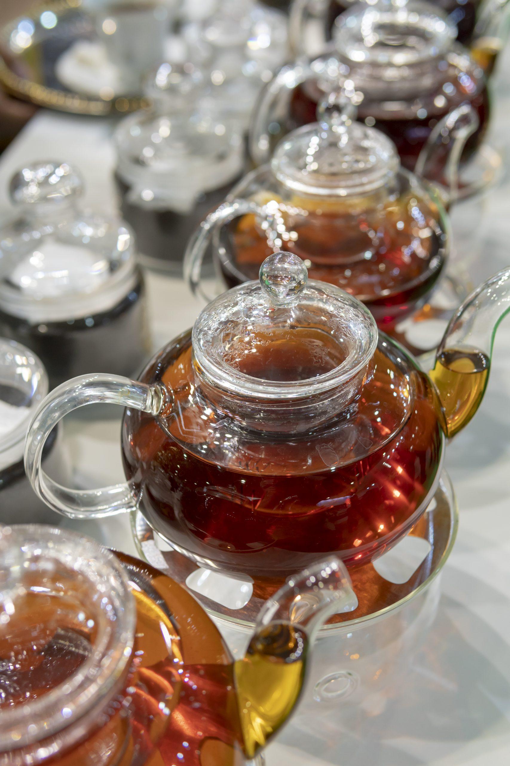Tea in a glass transparent teapot.